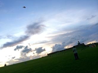 Kite-flying at sunset.