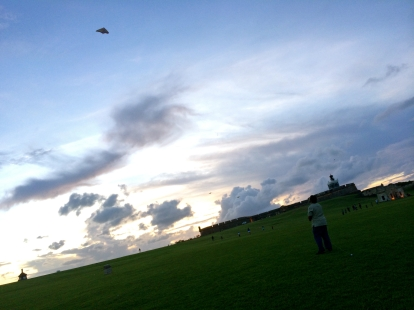 Kite-flying at sunset.